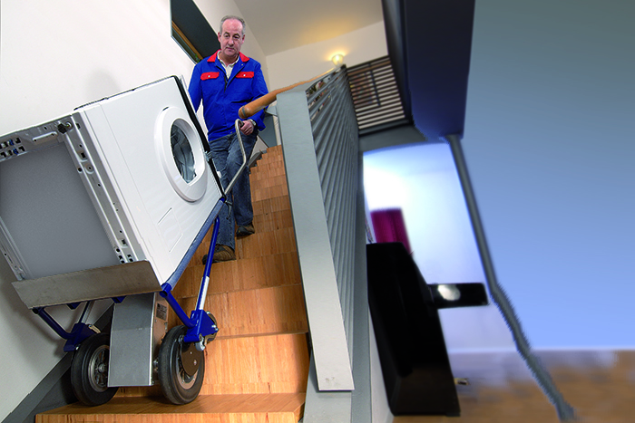 Electric stairwell cart A142 transports washing machine via stairs