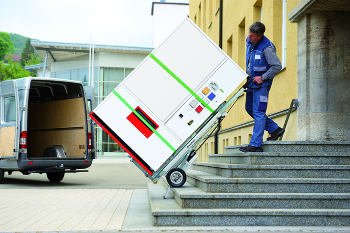 Electric stair climber CargoMaster C400 transports vending machines via external stairs