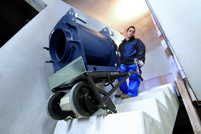 Electric stair sack cart A350 transports boiler via stairs